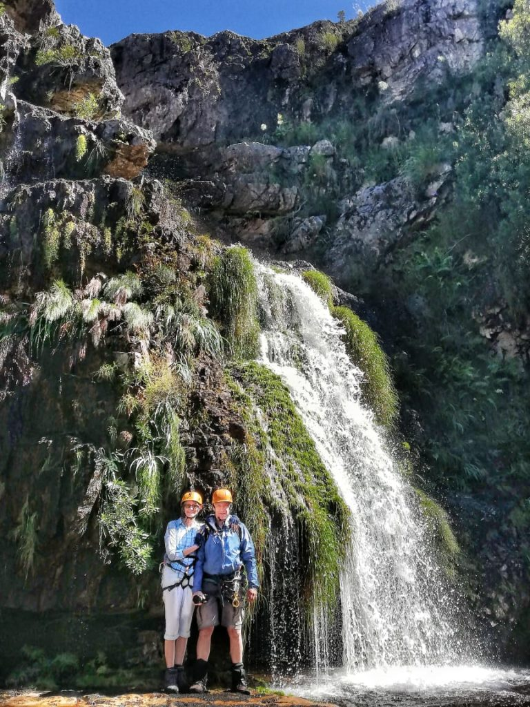 Couple infront of waterfall